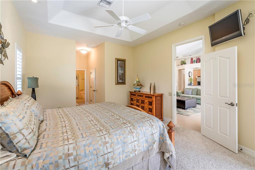 Large master with high, coffered ceiling. - Single Family Home for sale at 931 Linkside Way, Punta Gorda, FL 33955 - MLS Number is C7400849