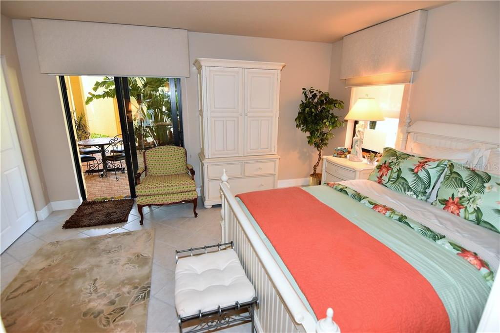 This second Guest Bedroom has access to the bricked and covered patio - Condo for sale at 3210 Southshore Dr #11a, Punta Gorda, FL 33955 - MLS Number is C7402449