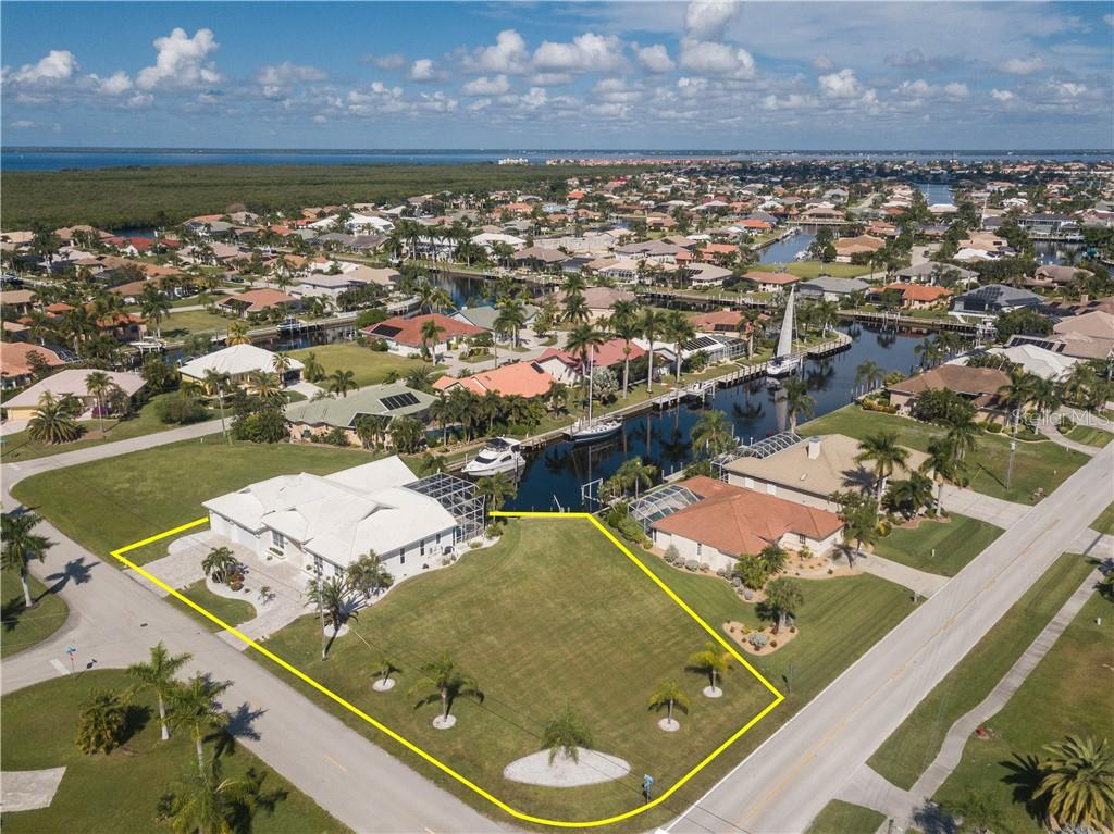 PGI DREAM HOME! CUSTOM 3/3/3 + DEN WATERFRONT POOL HOME WITH QUICK ACCESS TO CHARLOTTE HARBOR LEADING TO THE GULF OF MEXICO VIA PONCE INLET! - Single Family Home for sale at 2650 Ryan Blvd, Punta Gorda, FL 33950 - MLS Number is C7407961