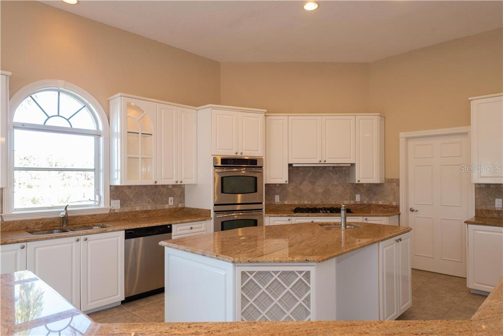 KITCHEN WITH CENTER PREP ISLAND - Single Family Home for sale at 13000 Windcrest Dr, Port Charlotte, FL 33953 - MLS Number is C7410459