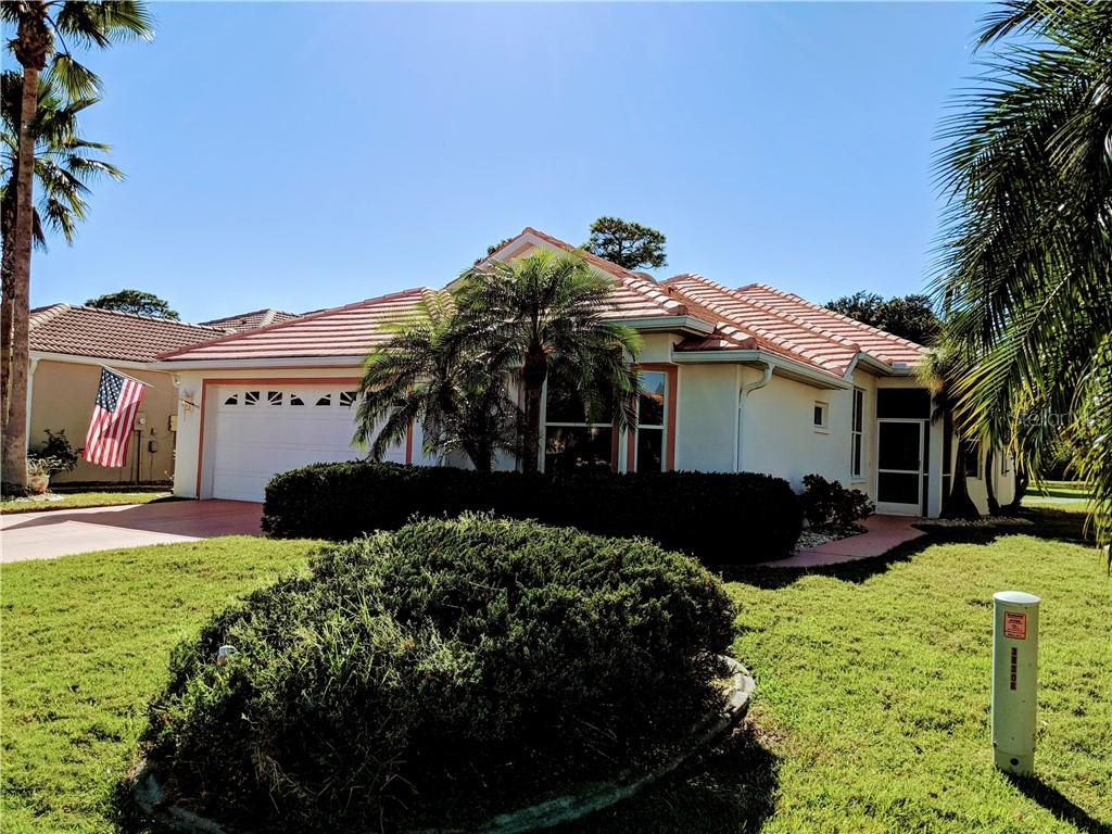 FRONT ELEVATION, TILE ROOF MATURE LANDSCAPING - Single Family Home for sale at 26442 Feathersound Dr, Punta Gorda, FL 33955 - MLS Number is C7412660