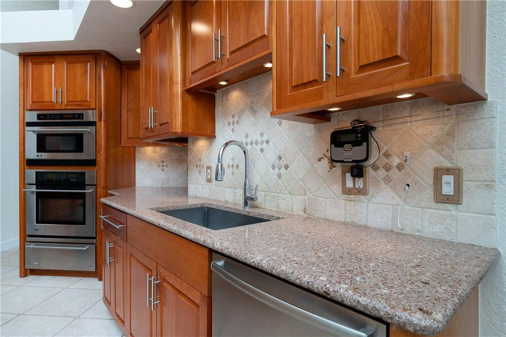 GE Monogram built in convection microwave, oven and warming drawer. Beautiful Cherry wood cabinets, Large Farmers sink. - Single Family Home for sale at 1309 Casey Key Dr, Punta Gorda, FL 33950 - MLS Number is C7413790