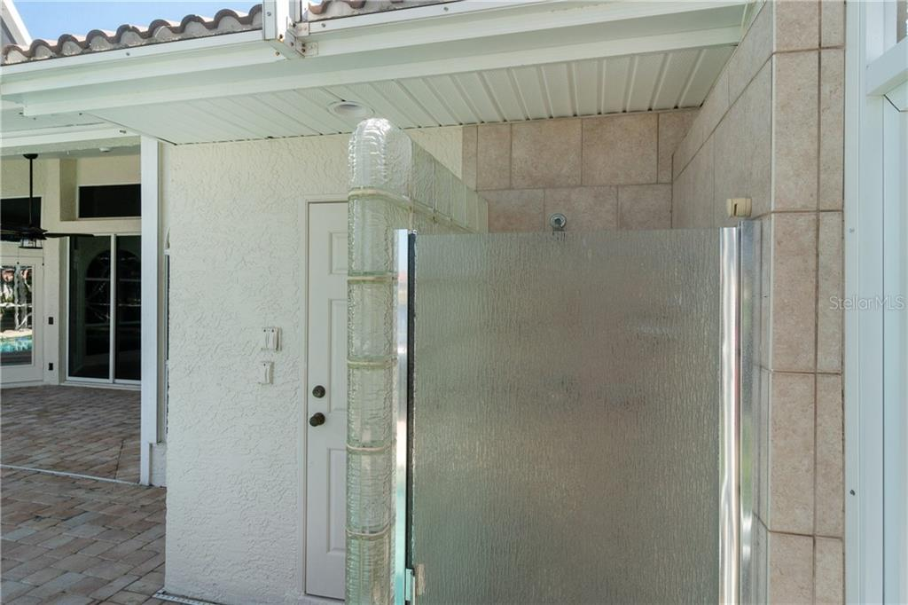 Now that a nice out door shower, Right next door to the pool 1/2 bath. - Single Family Home for sale at 1309 Casey Key Dr, Punta Gorda, FL 33950 - MLS Number is C7413790