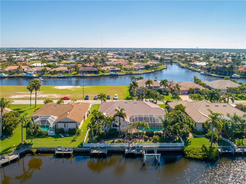 Beautiful Landscaping, fenced backyard, 2 docks, 1-10K Boat Lift - Single Family Home for sale at 1309 Casey Key Dr, Punta Gorda, FL 33950 - MLS Number is C7413790
