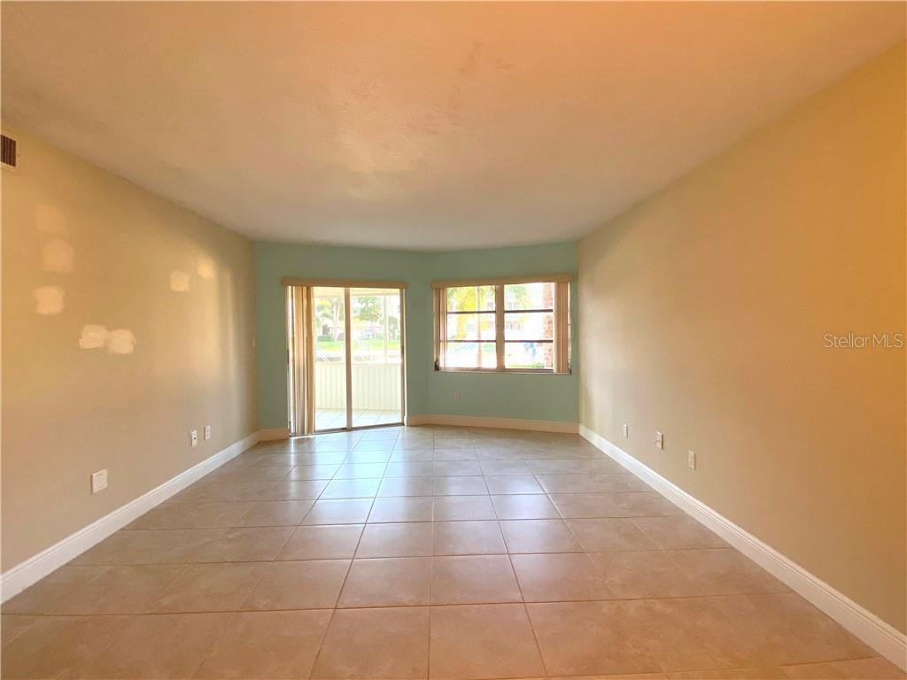 LIVING ROOM - Condo for sale at 1257 S Portofino Dr #106 (#38), Sarasota, FL 34242 - MLS Number is C7421453