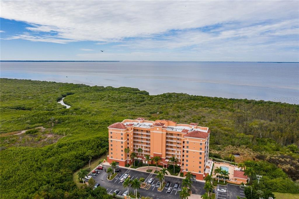 Aerial view of 3191 Matecumbe Key Rd with Charlotte Harbor in the background - Condo for sale at 3191 Matecumbe Key Rd #705, Punta Gorda, FL 33955 - MLS Number is C7423322