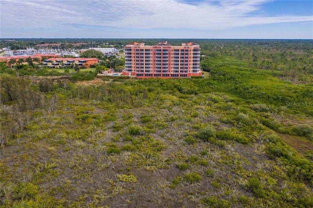 Back of Vista Del Sol from Charlotte Harbor - Condo for sale at 3191 Matecumbe Key Rd #705, Punta Gorda, FL 33955 - MLS Number is C7423322