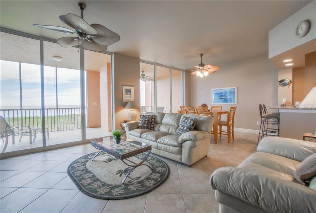 Living room with view out of the balcony - Condo for sale at 3191 Matecumbe Key Rd #705, Punta Gorda, FL 33955 - MLS Number is C7423322