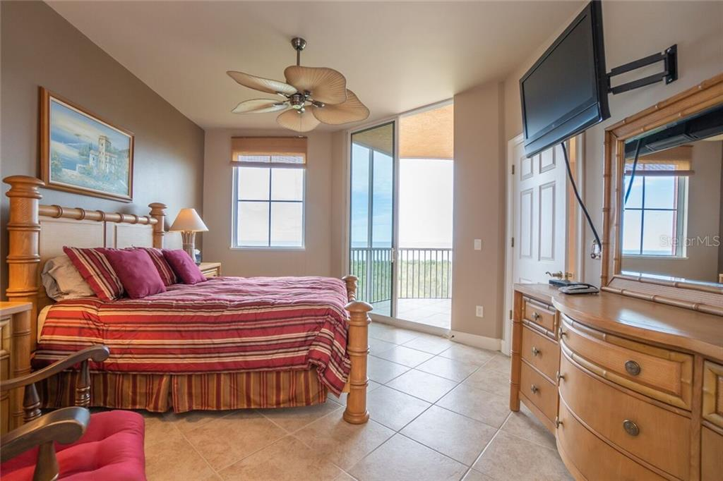Master bedroom looking out the balcony doors - Condo for sale at 3191 Matecumbe Key Rd #705, Punta Gorda, FL 33955 - MLS Number is C7423322