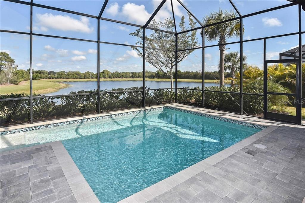 Single Family Home for sale at 15819 Kendleshire Ter, Lakewood Ranch, FL 34202 - MLS Number is C7427366