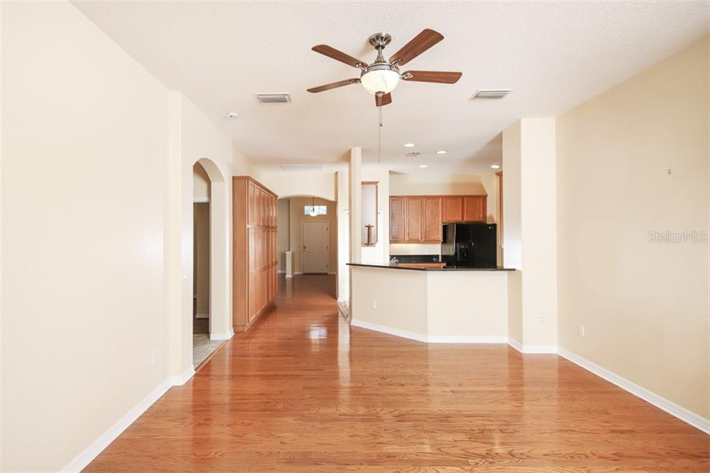 Family room - Single Family Home for sale at 1556 Scarlett Ave, North Port, FL 34289 - MLS Number is C7433452