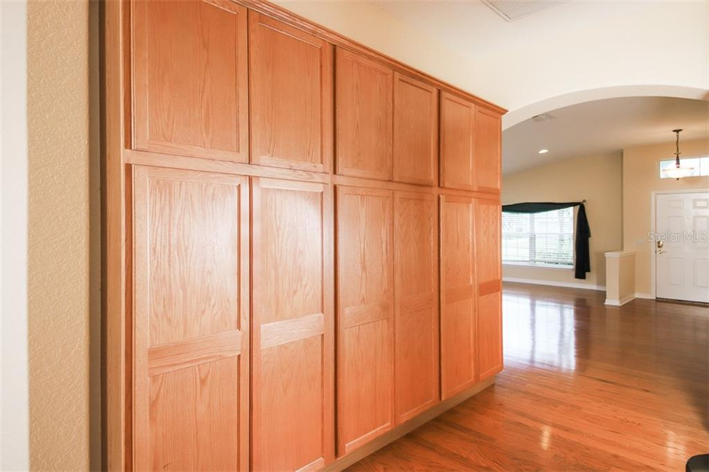 Built in cabinets for extra storage - Single Family Home for sale at 1556 Scarlett Ave, North Port, FL 34289 - MLS Number is C7433452