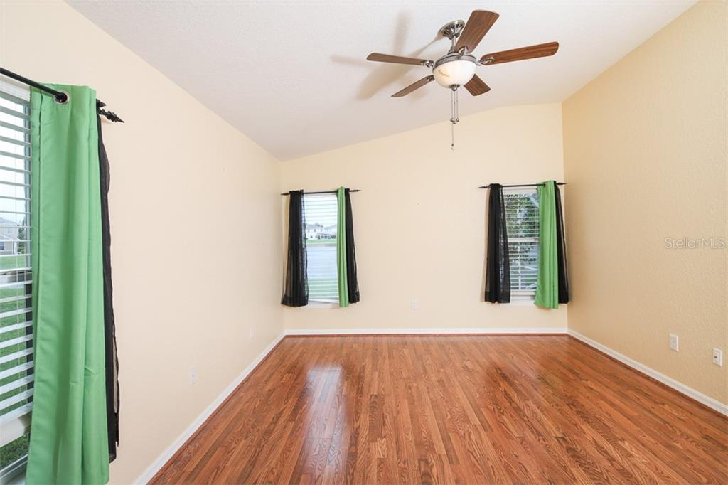 Master bedroom - Single Family Home for sale at 1556 Scarlett Ave, North Port, FL 34289 - MLS Number is C7433452