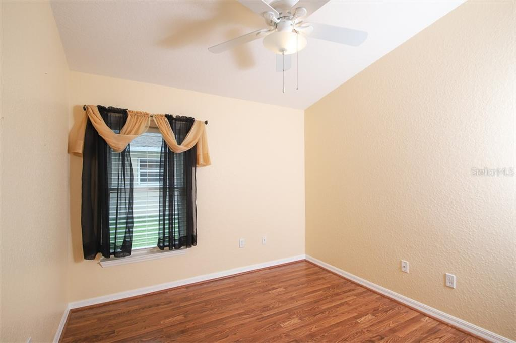 Bedroom 2 - Single Family Home for sale at 1556 Scarlett Ave, North Port, FL 34289 - MLS Number is C7433452