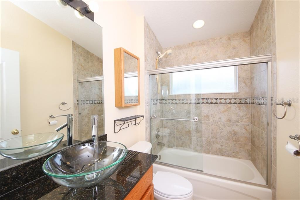 Bathroom 2 - Single Family Home for sale at 1556 Scarlett Ave, North Port, FL 34289 - MLS Number is C7433452