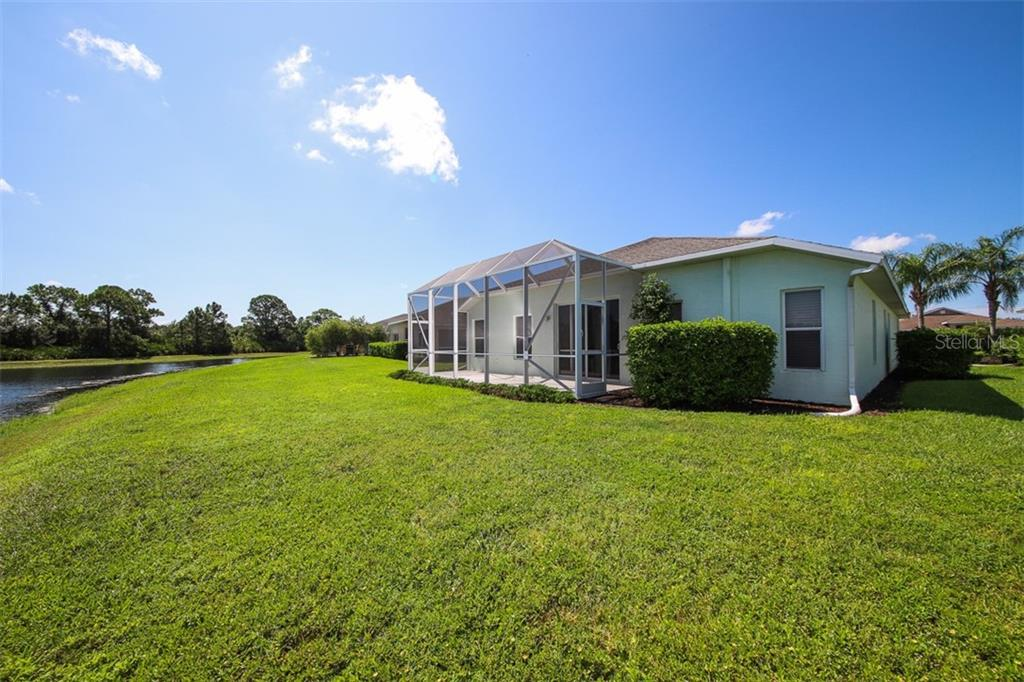 Single Family Home for sale at 1556 Scarlett Ave, North Port, FL 34289 - MLS Number is C7433452