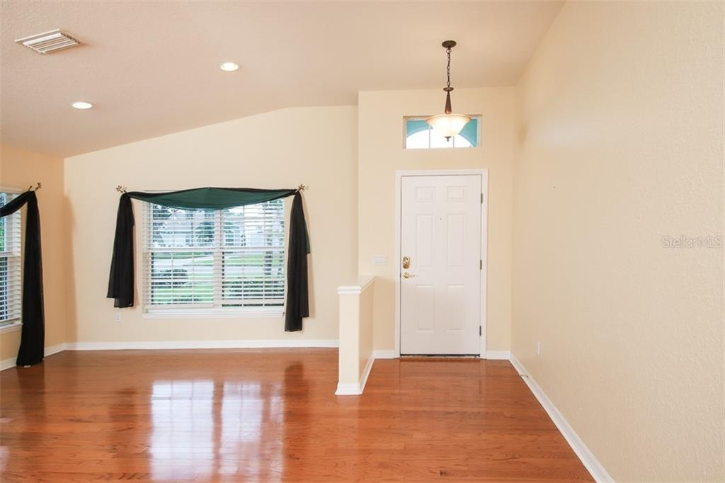 Entry and formal living room - Single Family Home for sale at 1556 Scarlett Ave, North Port, FL 34289 - MLS Number is C7433452
