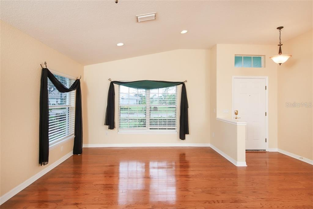 Formal living room - Single Family Home for sale at 1556 Scarlett Ave, North Port, FL 34289 - MLS Number is C7433452