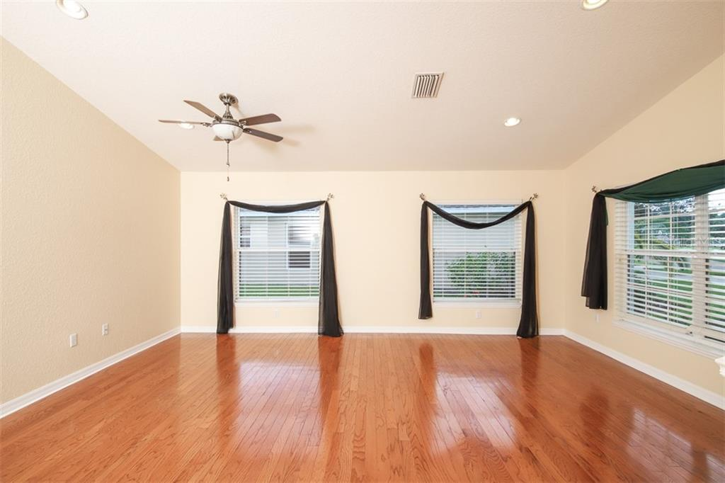 Formal living room/dining room - Single Family Home for sale at 1556 Scarlett Ave, North Port, FL 34289 - MLS Number is C7433452
