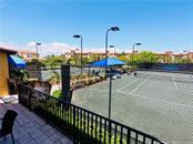 Tournament quality tennis courts with tennis ball launchers for solo practice, plus a lap pool. - Condo for sale at 98 Vivante Blvd #9828, Punta Gorda, FL 33950 - MLS Number is C7242665