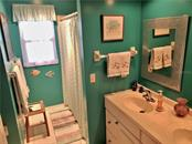 Guest bathroom with shower/tub combo - Single Family Home for sale at 24 Tiffany St, Englewood, FL 34223 - MLS Number is C7410842