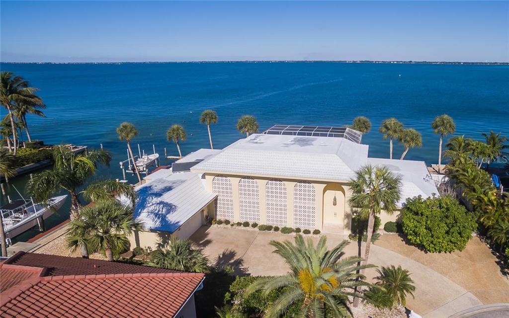 Частный дом для того Продажа на 601 Putting Green Ln 601 Putting Green Ln Longboat Key, Флорида,34228 Соединенные Штаты