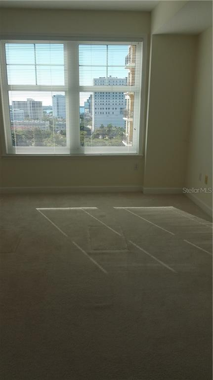 The Den is now unfurnished. Peeks to the water. - Condo for sale at 750 N Tamiami Trl #1108, Sarasota, FL 34236 - MLS Number is A4190640
