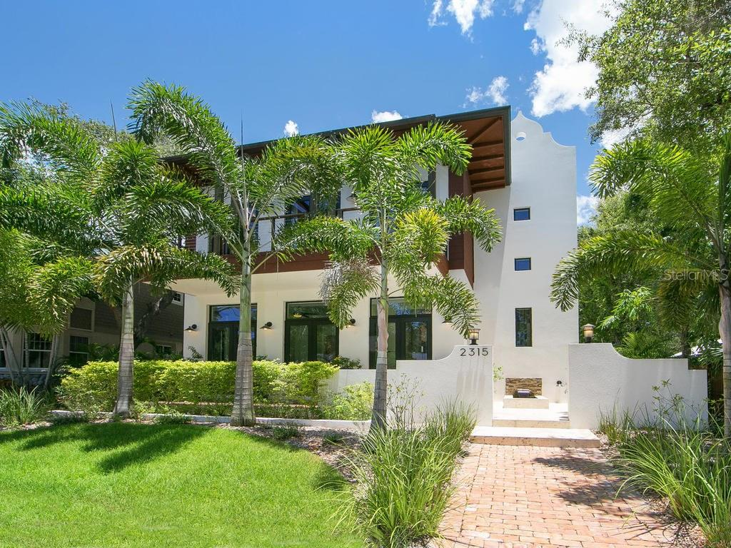 Tucked away moments from downtown and Southside Village, this chic modern retreat encompasses a four-bedroom main home and detached studio guest house. - Single Family Home for sale at 2315 Mietaw Dr, Sarasota, FL 34239 - MLS Number is A4191514
