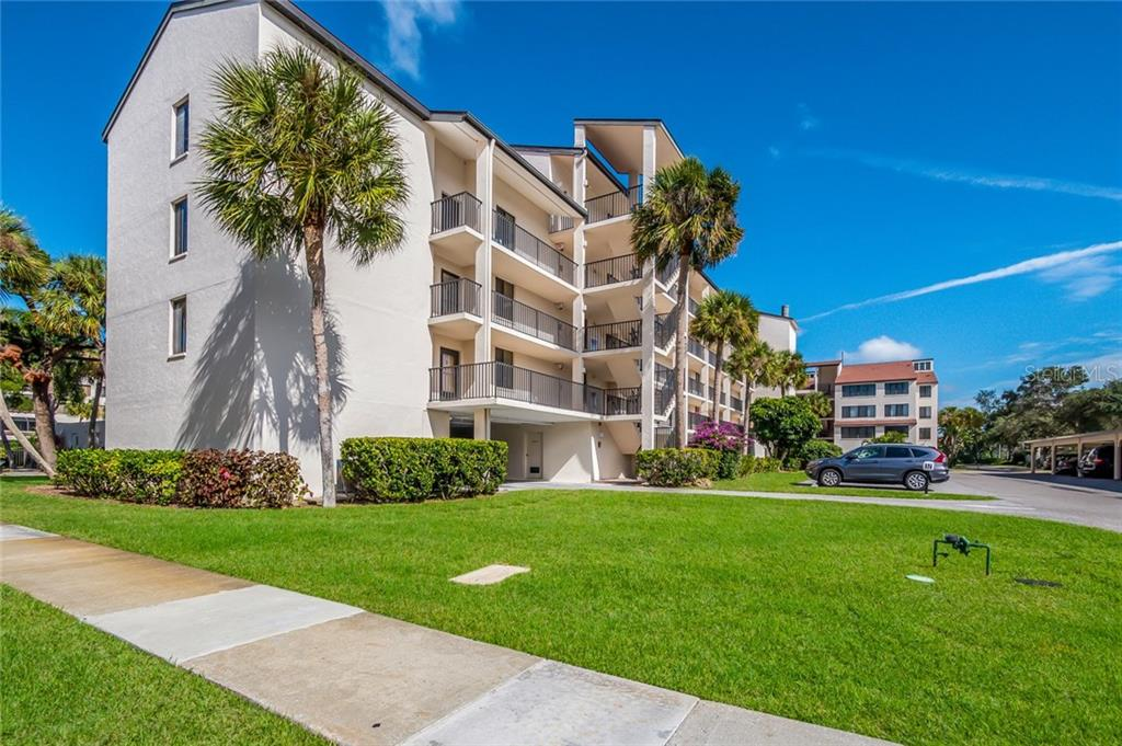 Front Exterior - Condo for sale at 6267 Midnight Pass Rd #101, Sarasota, FL 34242 - MLS Number is A4201357