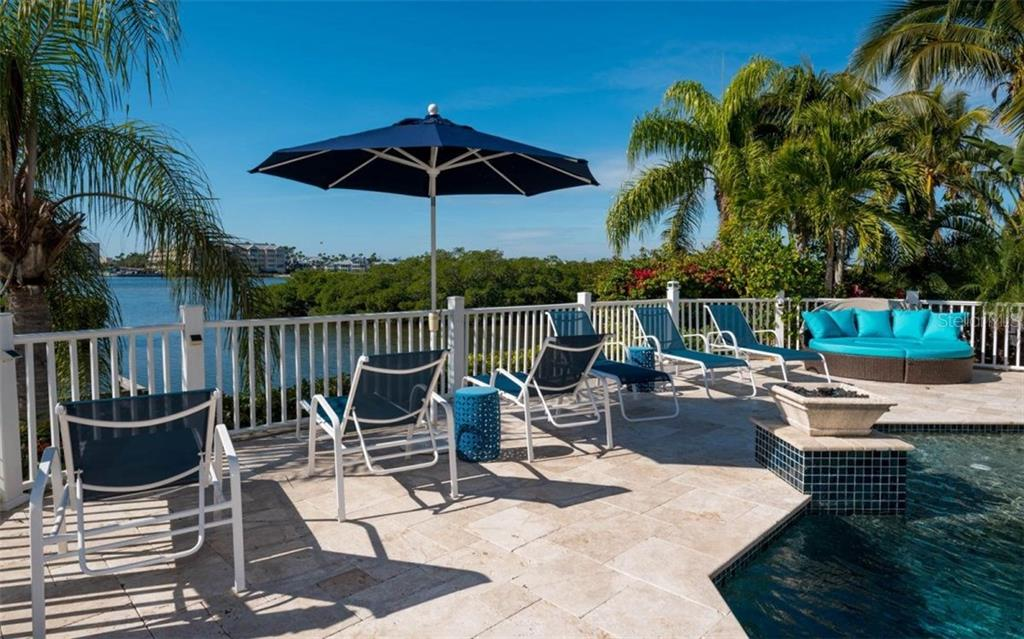 Stunning views with travertine deck and ample space for soaking in the Vitamin D! - Single Family Home for sale at 5824 Tidewood Ave, Sarasota, FL 34231 - MLS Number is A4205461