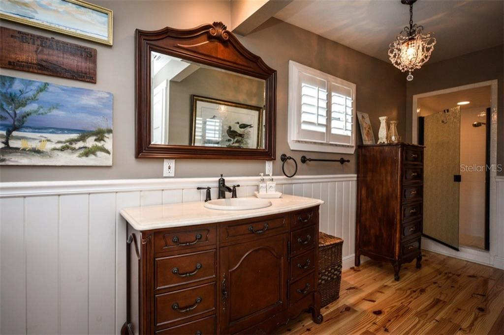 Master bath has a walk-in shower as well as a separate tub. - Single Family Home for sale at 306 Gulf Blvd, Anna Maria, FL 34216 - MLS Number is A4206962