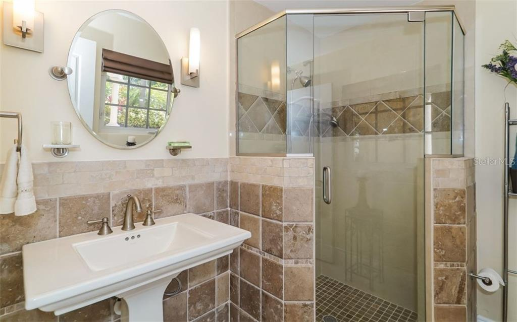 Downstairs ensuite master bath - Single Family Home for sale at 1179 Morningside Pl, Sarasota, FL 34236 - MLS Number is A4209174
