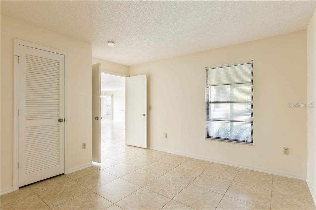 Third Bedroom or den offers double door entry & closet. - Villa for sale at 3606 Gleneagle Dr #9a, Sarasota, FL 34238 - MLS Number is A4403597