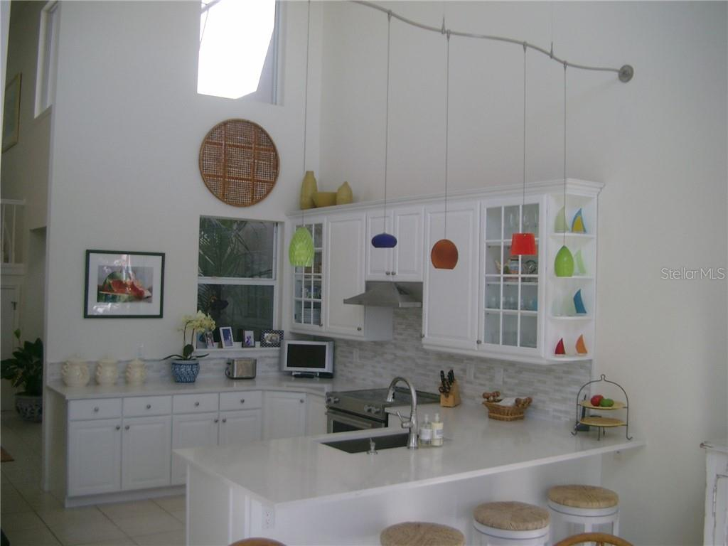 The new white Kitchen - Single Family Home for sale at 3452 Mistletoe Ln, Longboat Key, FL 34228 - MLS Number is A4415200