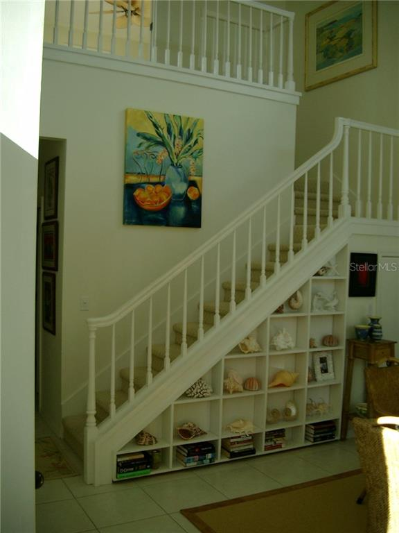 stairway to 2nd FL Guest Room w/underneath storage - Single Family Home for sale at 3452 Mistletoe Ln, Longboat Key, FL 34228 - MLS Number is A4415200