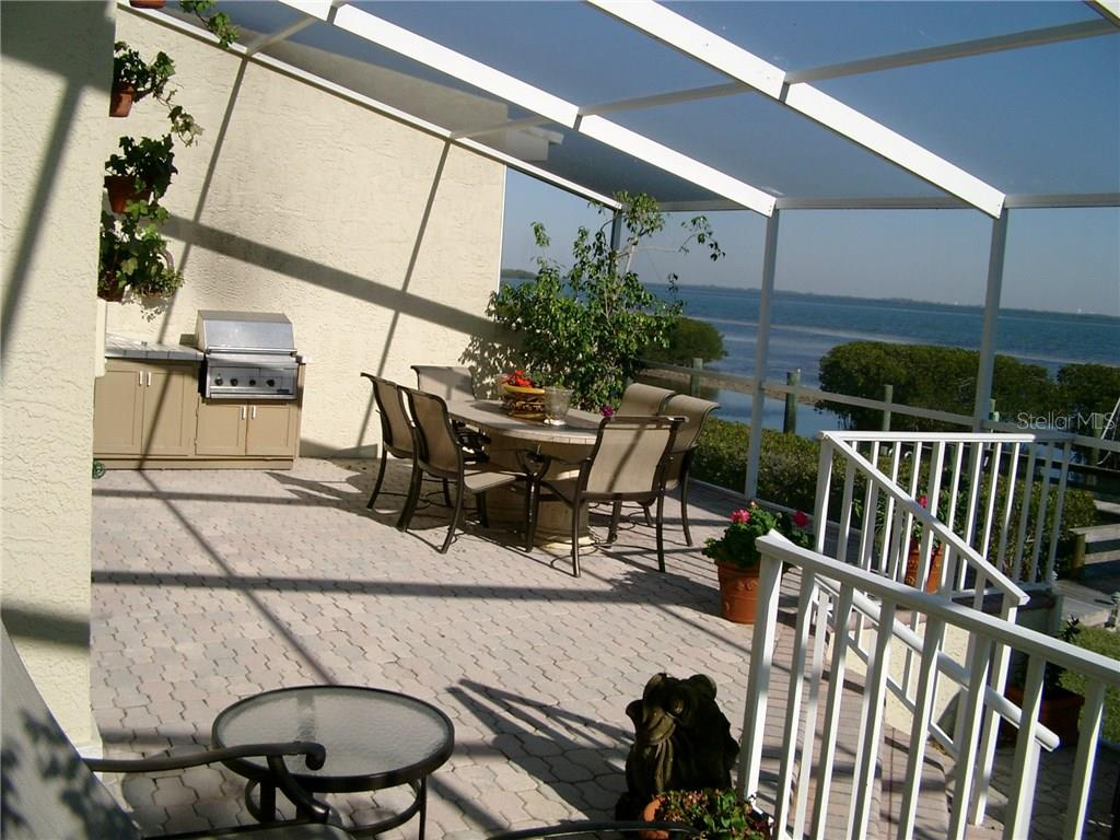 Private Lanai/Full Wall Separation (No open gap) / Gas BBQ on the Bay - Single Family Home for sale at 3452 Mistletoe Ln, Longboat Key, FL 34228 - MLS Number is A4415200