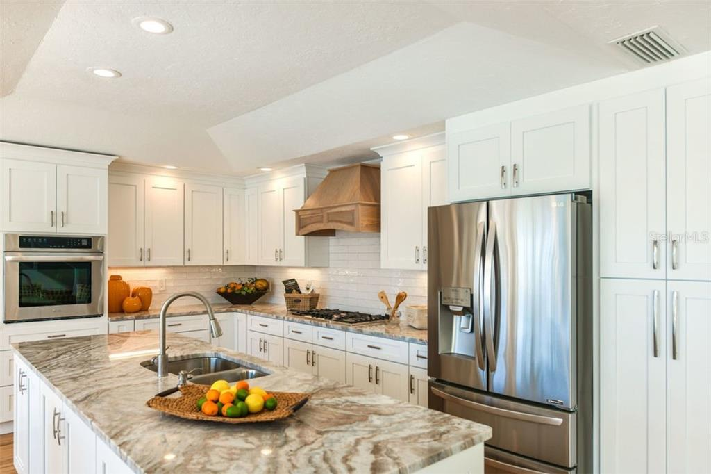 Stunning new kitchen, plenty of storage and same cabinets and quartz in Laundry room - Single Family Home for sale at 7689 Cove Ter, Sarasota, FL 34231 - MLS Number is A4417242