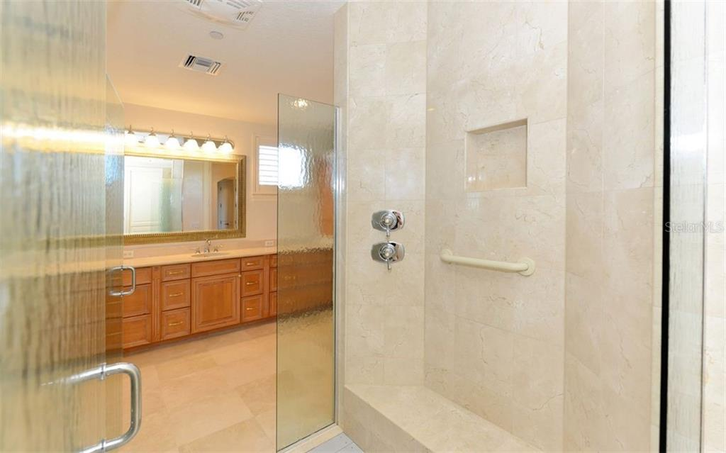 Larger Master bath with shared shower. - Condo for sale at 464 Golden Gate Pt #701, Sarasota, FL 34236 - MLS Number is A4422622