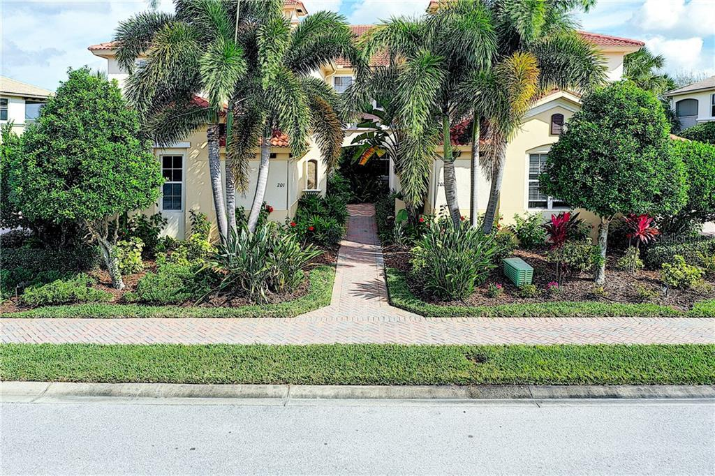 Front View - lush landscaping! - Condo for sale at 9453 Discovery Ter #201c, Bradenton, FL 34212 - MLS Number is A4423314