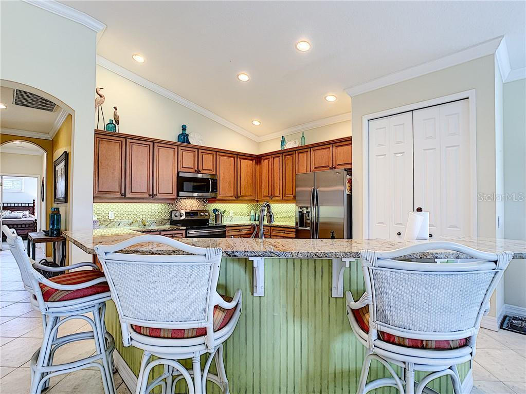 Kitchen breakfast bar, newer appliances and brand new dishwasher, large closet pantry. - Condo for sale at 9453 Discovery Ter #201c, Bradenton, FL 34212 - MLS Number is A4423314
