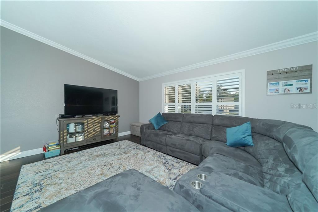 Great room - Single Family Home for sale at 8106 Timber Lake Ln, Sarasota, FL 34243 - MLS Number is A4423770