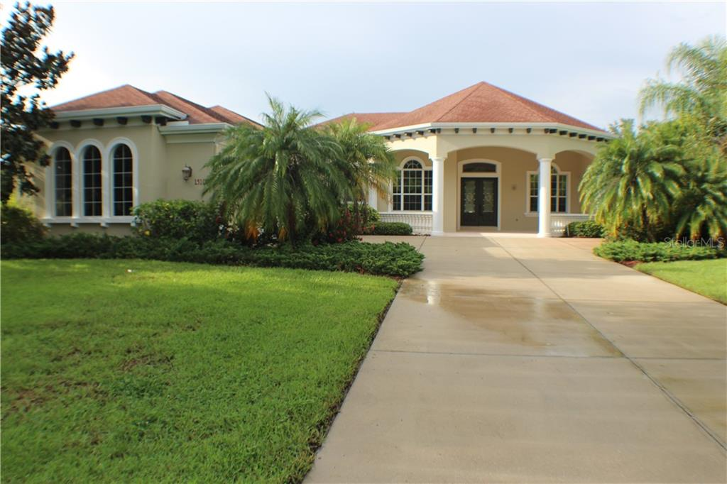 Beautifully landscaped yard and front exterior of home. - Single Family Home for sale at 15109 17th Ave E, Bradenton, FL 34212 - MLS Number is A4425963