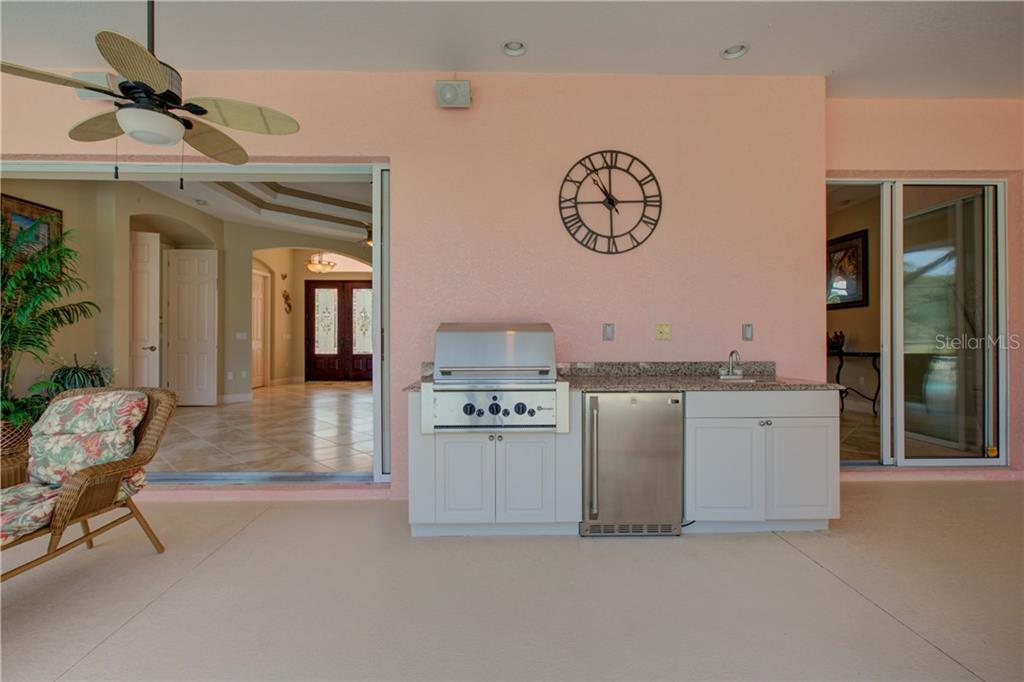 The outdoor kitchen is convenientally located and comes with plenty of countertop space, cabinetry, sink, and grill. - Single Family Home for sale at 15109 17th Ave E, Bradenton, FL 34212 - MLS Number is A4425963