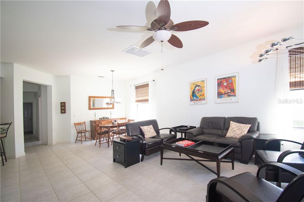 Living room looking towards the breakfast bar and entry hall - Villa for sale at 1808 Batello Dr, Venice, FL 34292 - MLS Number is A4426491