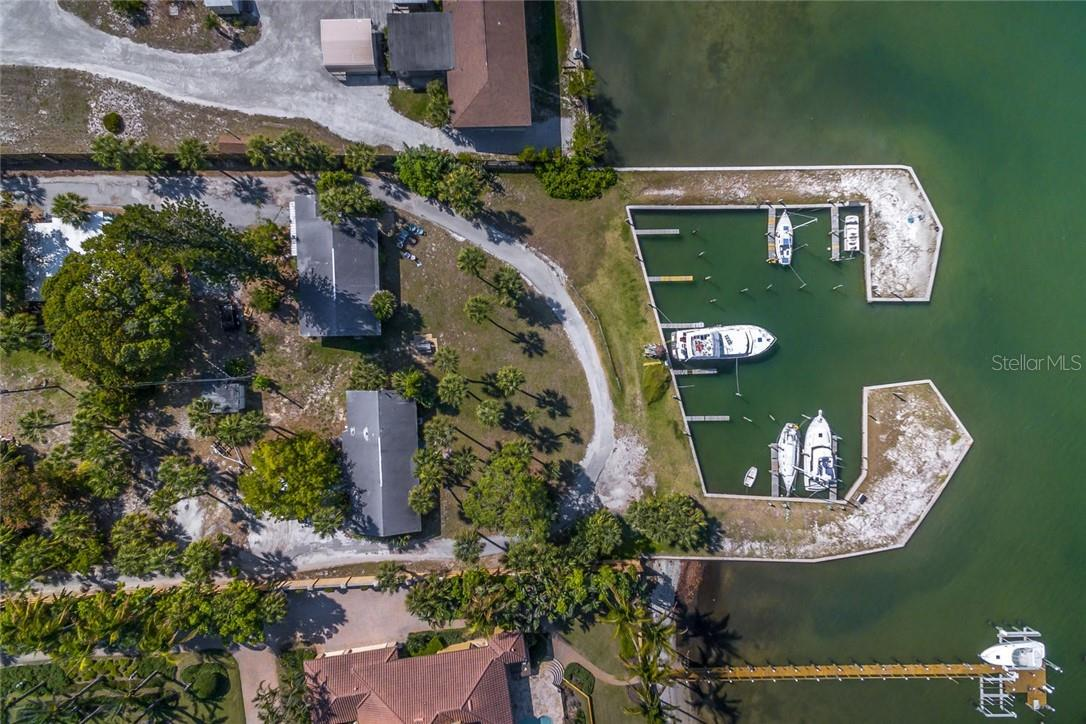 protected dockage - boat in center is 45'.  West Duplexes shown are in X flood zone. - Vacant Land for sale at 1649 Bayshore Rd, Nokomis, FL 34275 - MLS Number is A4426786
