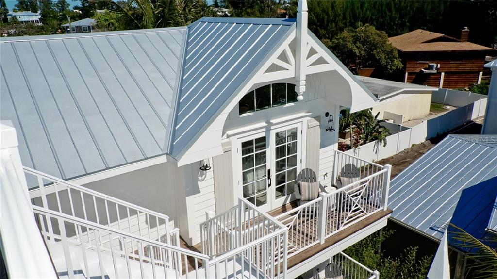 Staircase to rooftop - Single Family Home for sale at 720 North Shore Dr, Anna Maria, FL 34216 - MLS Number is A4428062