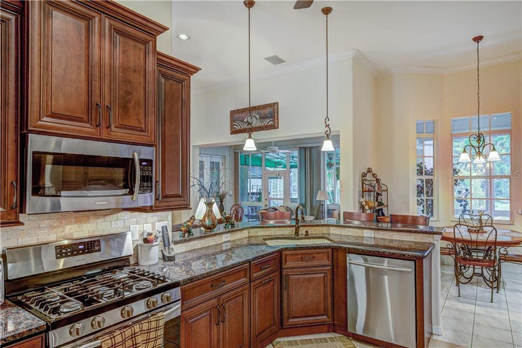 All new stainless appliances and granite counter tops, 5 burner gas stove - Single Family Home for sale at 6321 W Glen Abbey Ln E, Bradenton, FL 34202 - MLS Number is A4429610
