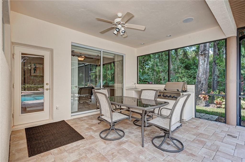 Single Family Home for sale at 4891 Carrington Cir, Sarasota, FL 34243 - MLS Number is A4430044