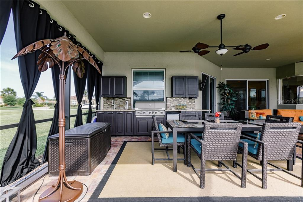 Outdoor dining room. - Single Family Home for sale at 17006 1st Dr E, Bradenton, FL 34212 - MLS Number is A4432830