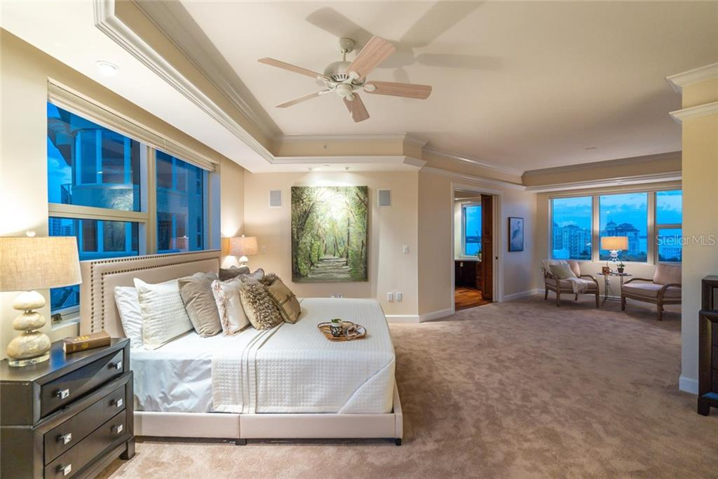Evening ambiance in your Master Suite with a comfortable seating area to relish the views and formal office! - Condo for sale at 128 Golden Gate Pt #902a, Sarasota, FL 34236 - MLS Number is A4433296